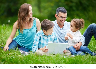 Happy family members spending time in the park