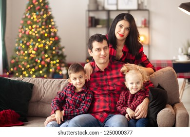 happy family, mom, dad, son and daughter at home rejoice at new year gifts, waiting for christmas and new year, happy childhood