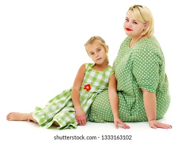 Happy family mom and little daughter, studio portrait on white background.Isolated.