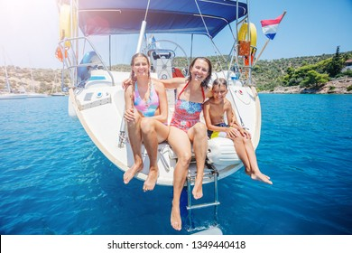 Happy family - mother with adorable daughter and son resting on a big yacht