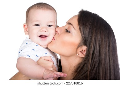 Happy Family. Mother and baby are kissing and hugging.