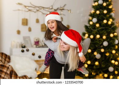 Happy family mother and baby little child playing in the winter for the Christmas holidays