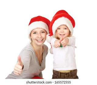 happy family mother and baby in red Christmas hats showing ok