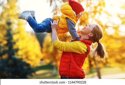 happy family mother and baby son  playing and laughing on   autumn walk