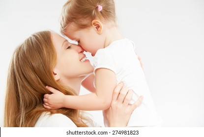 happy family mother and child baby daughter hugging and kissing