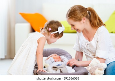 happy family. mother and children newborn baby and big sister