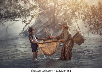 Happy family, mother and daughter fishing at river