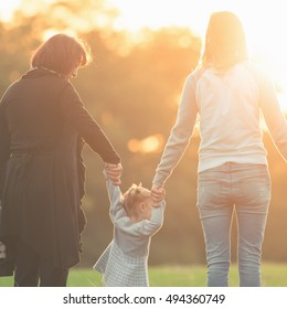 Happy family with mother, daughter and grandma outdoor. Fall season. Healthy concept. Mothercare is most important in baby life. International Children's Day at 20 November or June 1