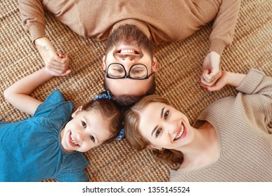 happy family mother father and child daughter laughing and havig fun at home