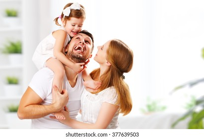 happy family mother, father,  child daughter at home