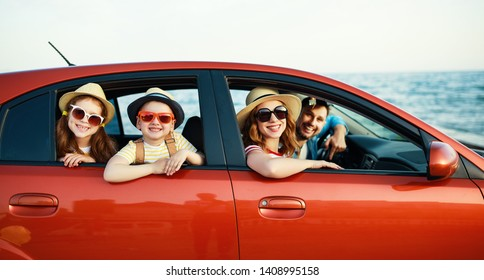 happy family mother father and children in summer auto journey travel by car on beach