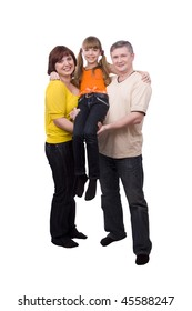Happy family. Mother and father are holding a little daughter. Woman, man and girl are standing  and smiling  on the floor and posing happily on white background.