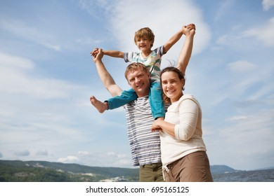 happy family mother, father and little son Having Fun outdoors in summer