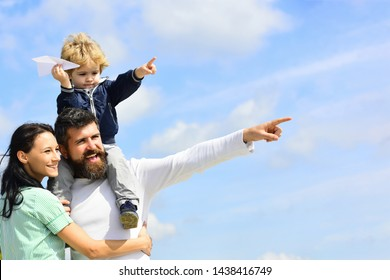 Happy family - mother, father and son on sky background in summer. Happy father giving son back ride on sky in summer. Family Time. Dream of flying