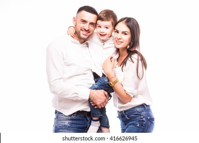 A happy family: mother, father and son on white background