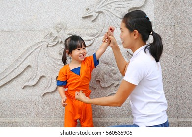 Happy family, Mother and her child girl are fighting at chinese temple.