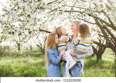 Happy family. mother of many children and three daughters child girl summer outdoors