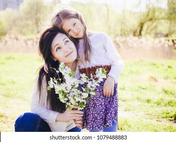 happy family . Mother play with child outdoor Happy mothers day