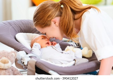 happy family. mother plays and laughs with her newborn baby
