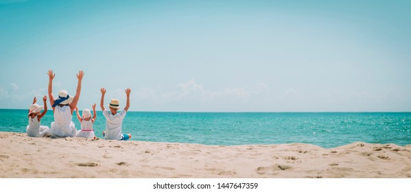happy family -mother with son and daughters-enjoy beach
