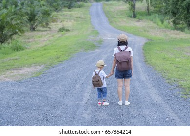 happy family. A mother and son walkingon the road  outdoors.Travel Vacation Summer Concept