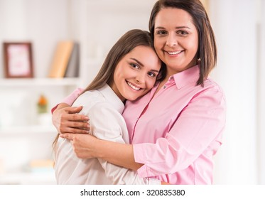A happy family. Mother and teen daughter at home.
