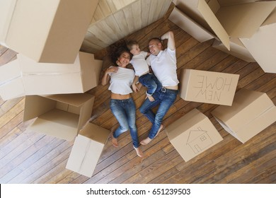 happy family moves into a new apartment