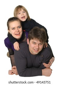 Happy family mum, the daddy, the son. It is isolated on a white background