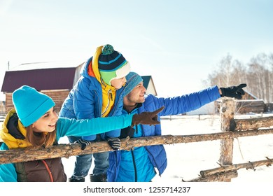 happy family near a house in the winter. active people outdoors