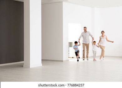 Happy family in new empty flat
