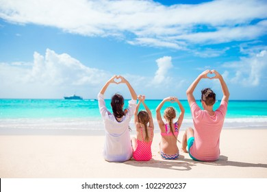 Happy family on a beach during summer vacation
