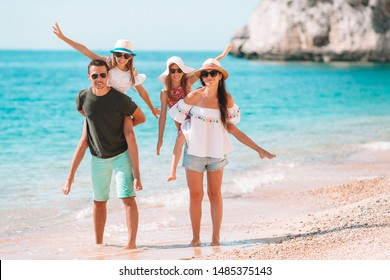 Happy family on the beach during european vacation
