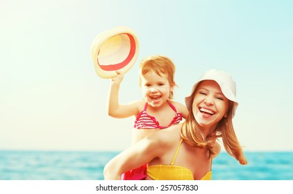 happy family on the beach. mother and baby daughter  at sea