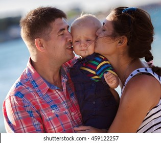 Happy family on the beach in summer day
