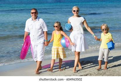 Happy family on beach on a sunny summer day