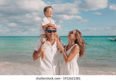 Happy family on the beach. Family vacation