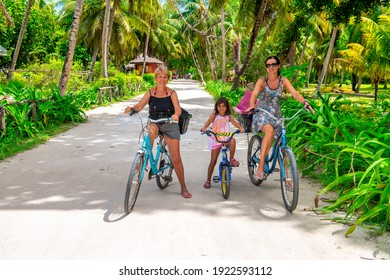Happy family on a bike tour, tropical destination. Holiday and travel concept.