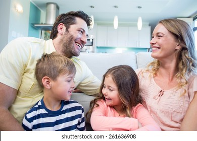 Happy family on the couch at home in the living room