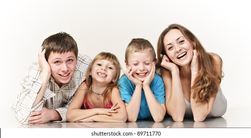 happy family on the floor smiling