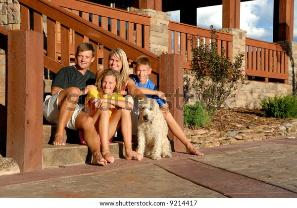 Happy family on front steps