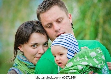 Happy family on a green background