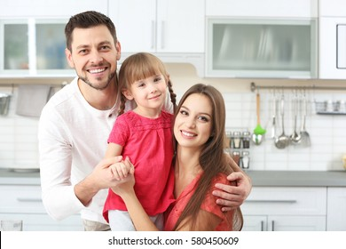 Happy family on kitchen at home