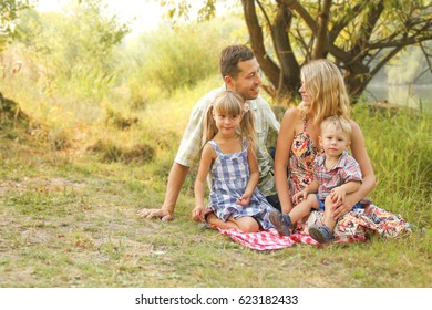 happy family on the nature of children rests with the road background