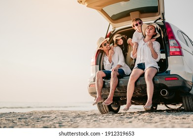 Happy family on a road trip in their car. Dad, mom and daughter are traveling by the sea. Summer ride by automobile.
