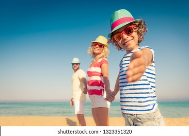 Happy family on summer vacation. People having fun on the beach