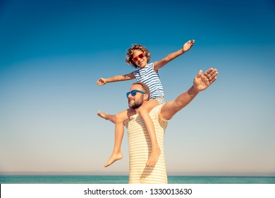 Happy family on summer vacation. People having fun on the beach. Active healthy lifestyle