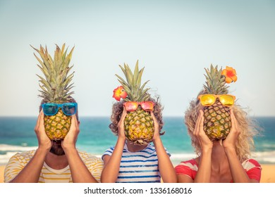 Happy family on summer vacation. People having fun on the beach. Healthy eating lifestyle