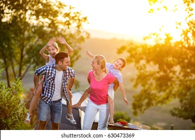 happy family on vacation playing together