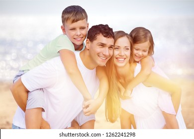 Happy family on vacations walking together