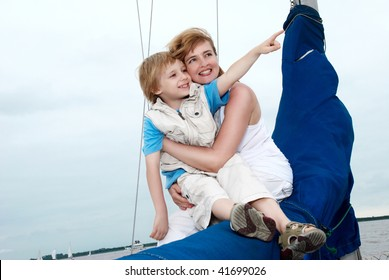 Happy family onboard the yacht. A vacation